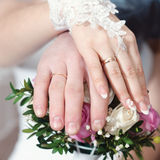 Hands wearing wedding rings Royalty Free Stock Photos