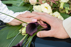Hands with wedding. Rings and flower bouquet Stock Image