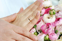 Hands on wedding bouquet. Hands and rings on wedding bouquet Stock Image