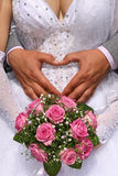 Hands on wedding bouquet Stock Images