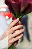 Hands with wedding bouquet Royalty Free Stock Photo