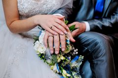 Hands on wedding bouquet Royalty Free Stock Image