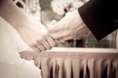 Hands of wedding bride and groom Stock Photo