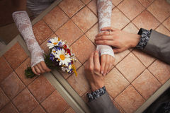 Hands of wedding couple Stock Images