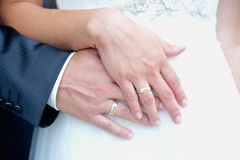 Hands of a Wedding Couple royalty free stock images