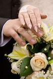Hands and wedding flowers Royalty Free Stock Photos