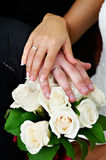 Hands with wedding gold and bouquet of flowers Royalty Free Stock Photos