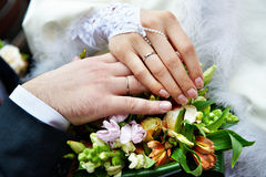 Hands with wedding gold rings Stock Photos