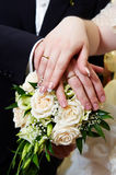Hands with wedding gold rings Stock Photo