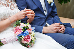 Hands with wedding gold rings and bouquet Royalty Free Stock Photo
