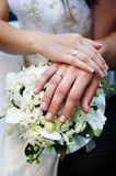 Hands with wedding gold rings and flowers Royalty Free Stock Images
