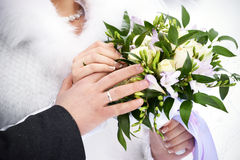 Hands with wedding gold rings and flowers Stock Photos