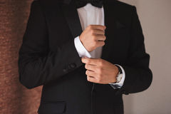 Hands of wedding groom getting ready stock image