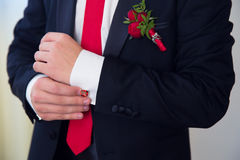 Hands of wedding groom getting ready in suit. Royalty Free Stock Photos