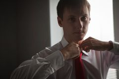 Hands of wedding groom getting ready in suit Royalty Free Stock Photography