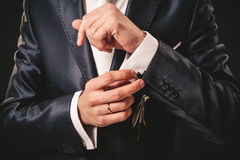 Hands of wedding groom getting ready in suit Royalty Free Stock Image
