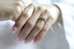 Hands with wedding rings. Wedding rings on hands of bride and groom, focus on rings Stock Image