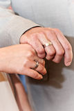 Hands with wedding rings. Married couple holding hands together with wedding rings Stock Photos