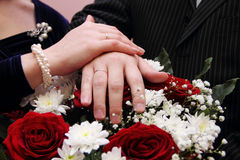 Hands with wedding rings Stock Photos
