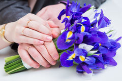 Hands with wedding rings and fower bouquet Royalty Free Stock Images