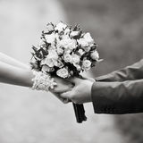 Hands of a weddingl couple in black and white Royalty Free Stock Photos