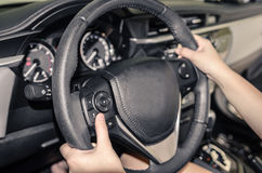 Hands on the wheel Royalty Free Stock Images
