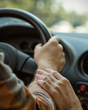 Hands on the wheel Royalty Free Stock Photos