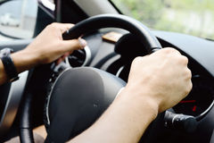 Hands on wheel Stock Image