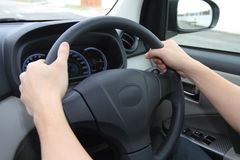 Hands on wheels Royalty Free Stock Photo