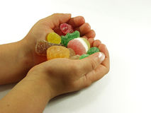 Hands whit candy. Boy hands whit assorted colored candies Royalty Free Stock Photos