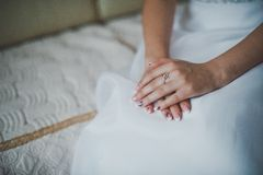 Hands on a white dress 2029. Hands of the girl lie on a white dress royalty free stock photos