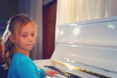 Hands on the white Keys of the Piano Playing a Melody. Women`s H stock photos