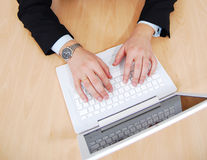 Hands on white laptop Royalty Free Stock Images