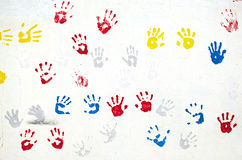 Hands on the white wall Royalty Free Stock Photo