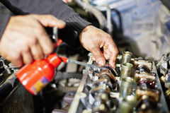 Hands, who lubricates car engine Royalty Free Stock Images