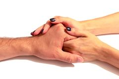 The hands of the wife gently hold the hand of her husband. Isolate on white background, close-up. The concept of caring and royalty free stock image