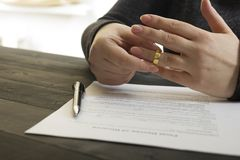 Hands of wife, husband signing decree of divorce, dissolution, canceling marriage, legal separation documents, filing. Divorce papers or premarital agreement Stock Photo