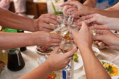 Hands and wine-glasses. stock image