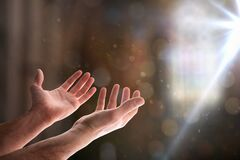 Free Hands With Palms Up In Church With Ray Of Light Royalty Free Stock Images - 173348509