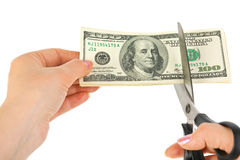Hands With Scissors Cutting Money Royalty Free Stock Image