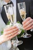 Hands With Wedding Rings Holding Glassis Of Wine Stock Image