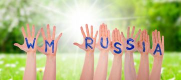 Hands With WM Russia Means Russia 2018, Sunny Grass Meadow Royalty Free Stock Images