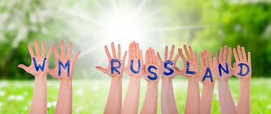 Hands With WM Russland Means Russia 2018, Sunny Grass Meadow Stock Photography