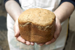 Hands of woman baker with homemade bread Royalty Free Stock Photo