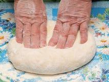 Kneading dough Stock Photography