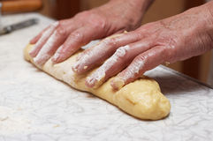 Hands of woman baker kneading dough Royalty Free Stock Photo