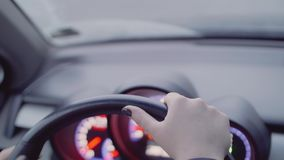 Hands` of woman on streering wheel. She unparks car turning steering wheel. Hands` of woman on black streering wheel. She unparks car turning steering wheel stock video
