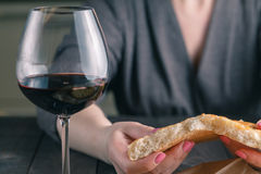 Hands of a woman breaking and sharing bread Stock Photo