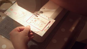 Hands of a woman crafting and scrap-booking christmas cards.  stock video footage