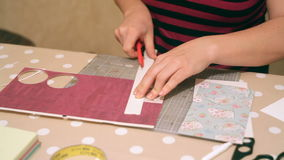 Hands of a woman crafting and scrap-booking christmas cards stock video footage